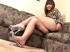 The beautiful and gorgeous Rifana Koda in a lovely cheetah inspired dress smiles and strikes some hot poses on the couch. She then starts showing off